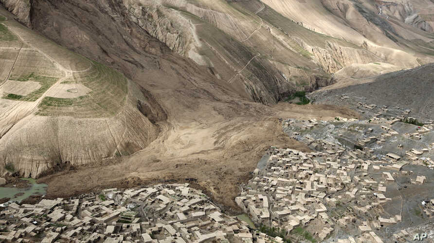 An ariel view shows the site of Friday's landslide that buried Abi Barik village in Badakhshan province, northeastern Afghanistan, Monday, May 5, 2014. Hundreds of people were killed in a horrific landslide and authorities are trying to help the 700