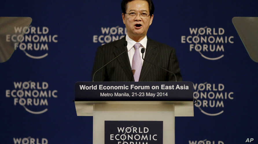 Vietnamese Prime Minister Nguyen Tan Dung addresses delegates at the  opening of the two-day World Economic Forum on Asia,  May 22, 2014 at the financial district of Makati, east of Manila, Philippines.