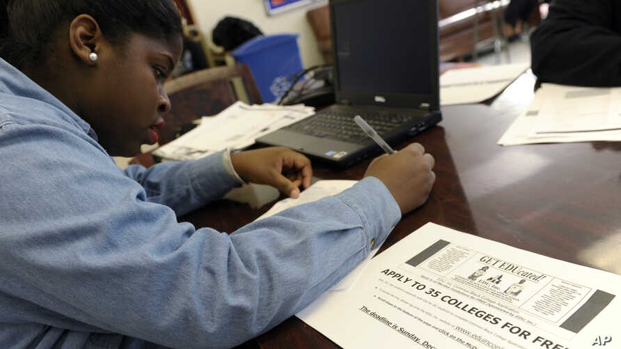 A student at Roosevelt High School fills out a college enrollment application at her school in Washington, D.C., Nov. 14, 2013.