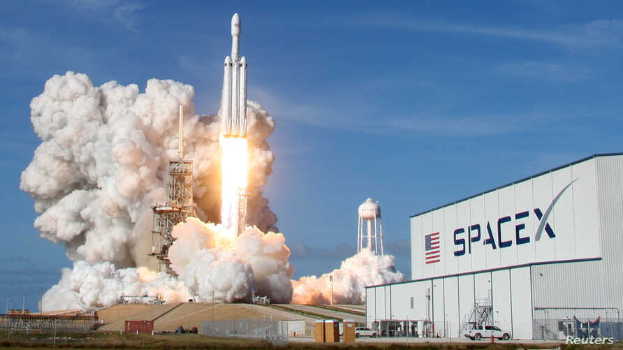 FILE - A SpaceX Falcon Heavy rocket lifts off from historic launch pad 39-A at the Kennedy Space Center in Cape Canaveral, Florida, Feb. 6, 2018.