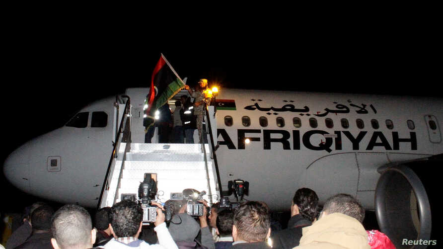 Passengers from a plane that was hijacked and diverted to Malta return to Tripoli's Mitiga International Airport, Libya, Dec. 24, 2016.
