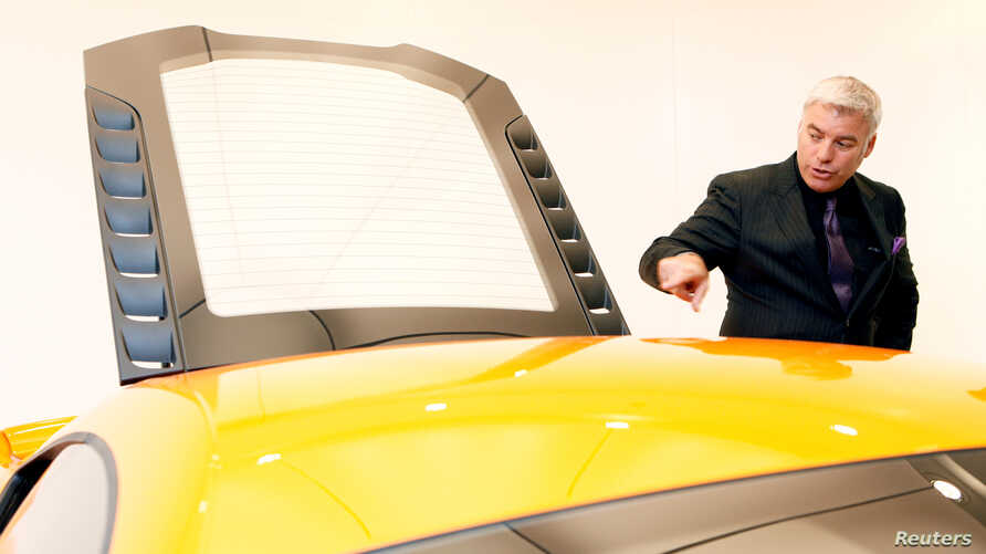 FILE - Designer Frank Stephenson attends the opening of the McLaren Brussels showroom, in Brussels, Belgium, Aug. 25, 2011. Stephenson has been picked by German company Lilium to help desing a lightweight aircraft powered by electric jet engines moun