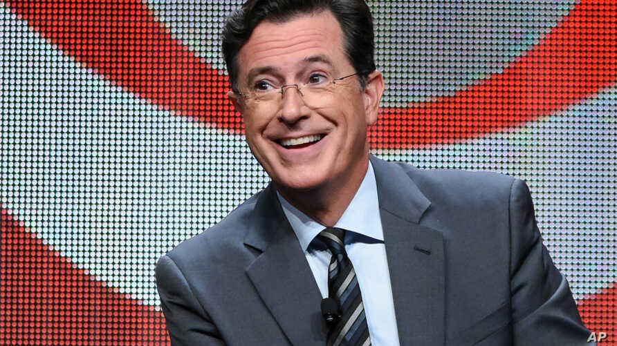 """FILE - Stephen Colbert participates in the """"The Late Show with Stephen Colbert"""" segment of the CBS Summer TCA Tour in Beverly Hills, California, Aug. 10, 2015."""