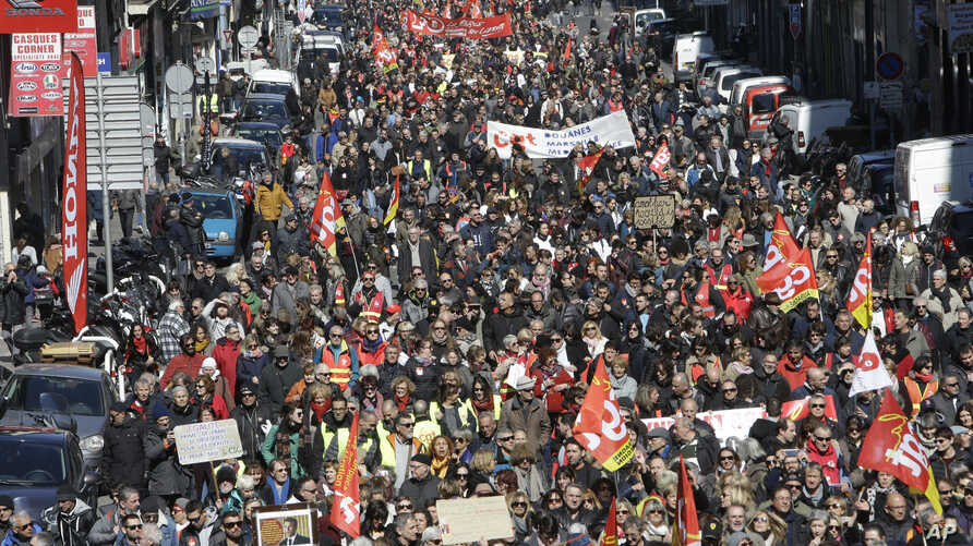 People march during a demonstration in Marseille, southern France, March 22, 2018.