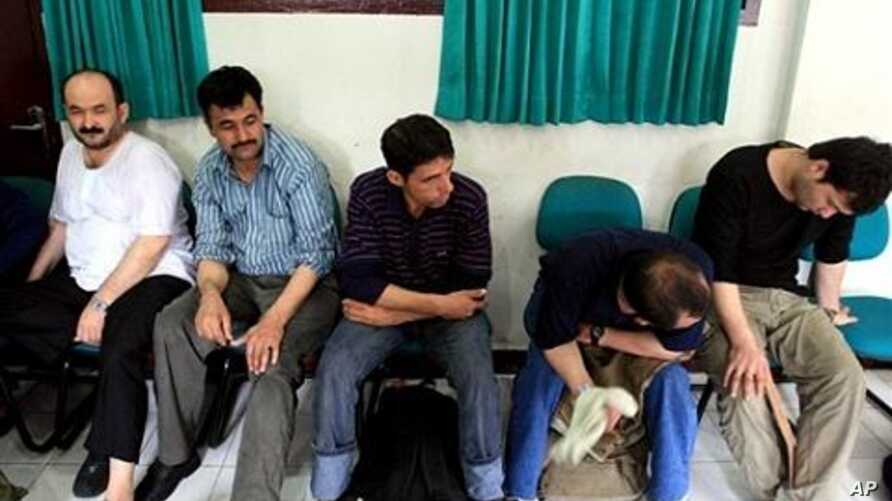 Suspected Afghan illegal immigrants, who were in transit in the province of North Sumatra, possibly bound for Australia, rest at a police station in Medan, Indonesia, after being brought in for questioning (File Photo)