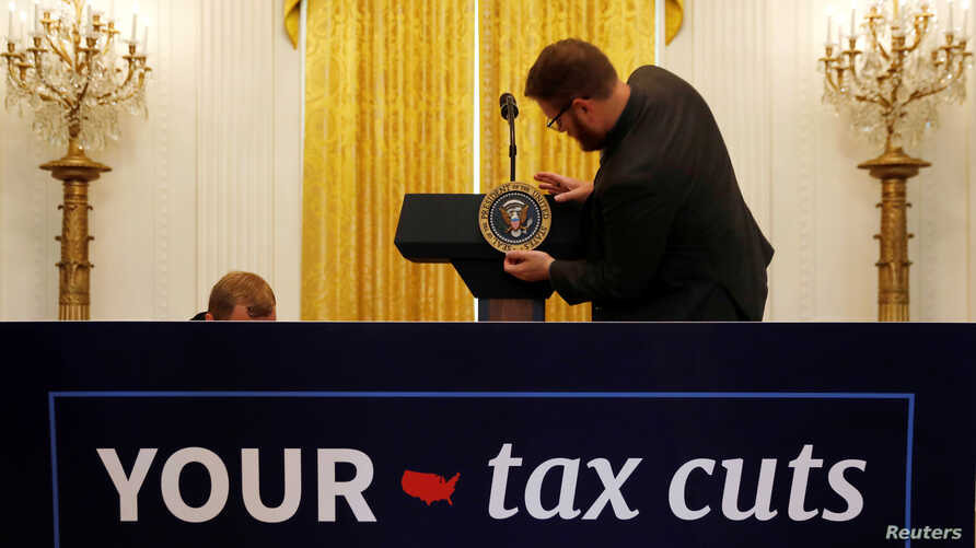 The presidential seal is placed on the lectern before U.S. President Donald Trump delivers remarks celebrating six months since his tax cuts victory at the White House in Washington, June 29, 2018.