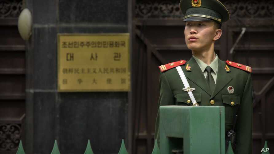 A Chinese paramilitary policeman stands guard outside of the North Korean Embassy in Beijing, April 20, 2017.