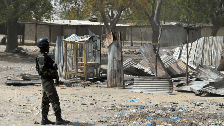 FILE - A picture taken on February 17, 2015 shows a Cameroonian soldier walking  in the Cameroonian town of Fotokol, on the border with Nigeria, after clashes occurred on Feb.  4 between Cameroonian troops and Nigeria-based Boko Haram insurgents.