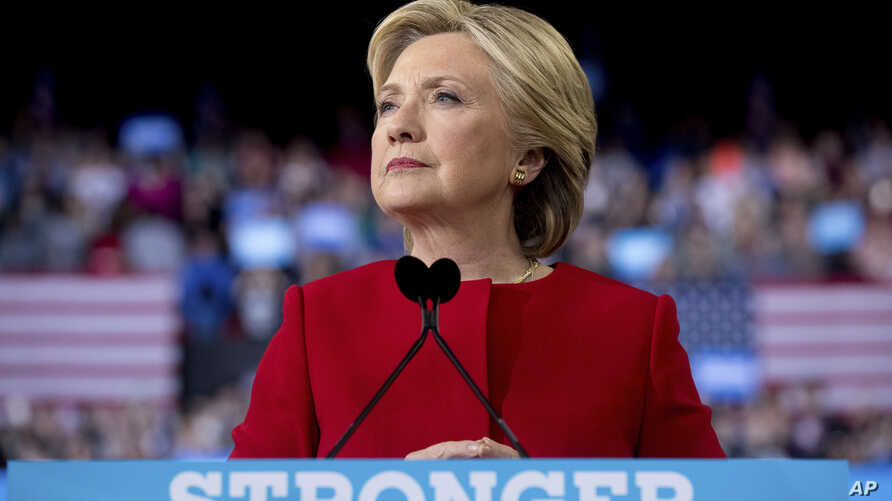 Democratic presidential candidate Hillary Clinton pauses as she speaks during a campaign rally in Raleigh, N.C.,  Nov. 8, 2016.