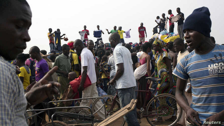 People sell clothes at the displaced camp at Mpoko international airport in Bangui, Central African Republic, Feb. 26, 2014.