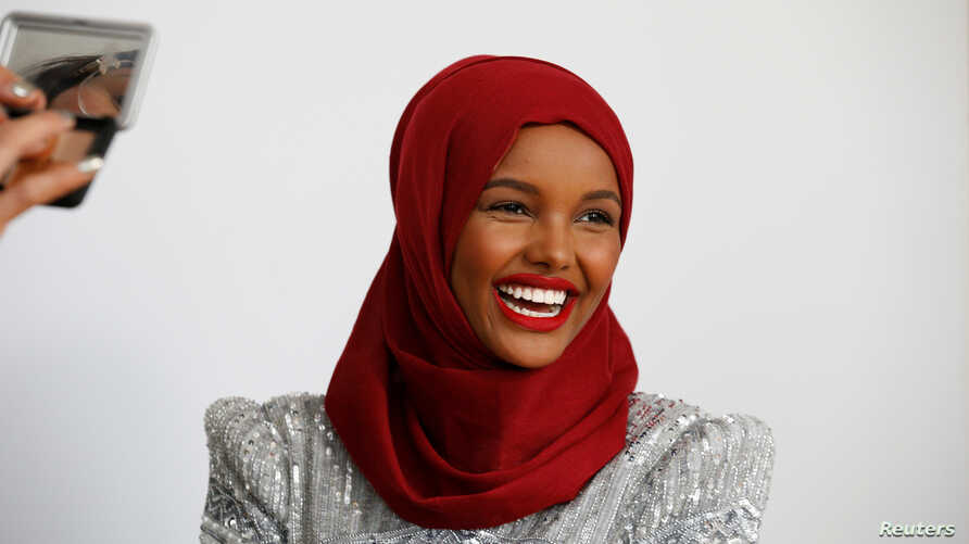 Fashion model and former refugee Halima Aden has her makeup applied during a shoot at a studio in New York City, Aug. 28, 2017.