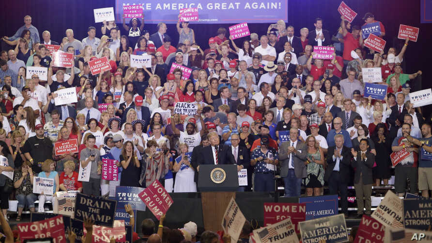 President Donald Trump speaks at a rally at the Phoenix Convention Center, Tuesday, Aug. 22, 2017, in Phoenix.
