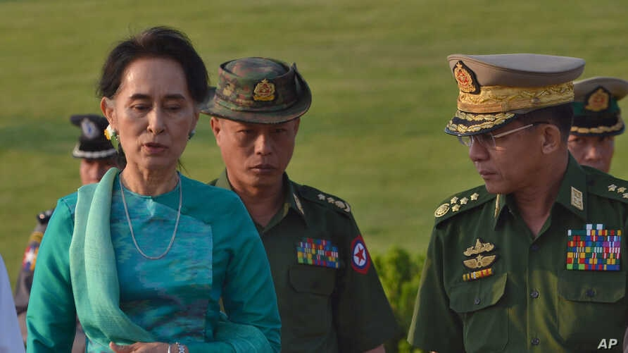 Aung San Suu Kyi, Myanmar's foreign minister and de facto leader, left walks with senior General Min Aung Hlaing, Myanmar's  commander-in-chief, right in the airport of capital Naypyitaw, Myanmar on May 6, 2016.