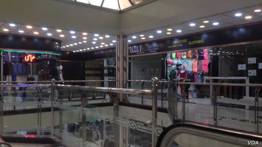 Stores were open in a shopping mall in Baneh, Iran, May 18, 2018, but it was virtually deserted of customers who have stayed away from the city. Local residents blame the lack of business on Tehran's monthslong blockade of border footpaths, which Ban