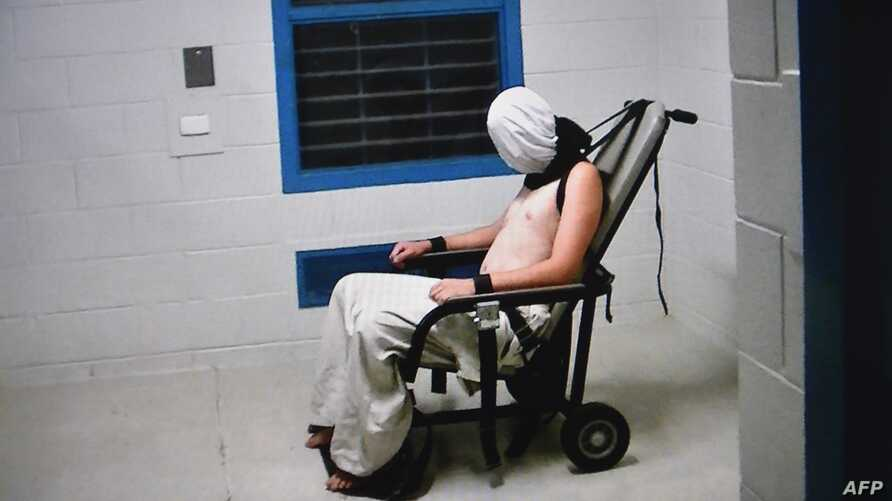 This frame grab from Australian Broadcasting Corporation's (ABC) Four Corners program broadcast in Australia on July 25, 2016 and released on July 26, 2016 allegedly shows a teenage boy hooded and strapped into a chair at a youth detention center in