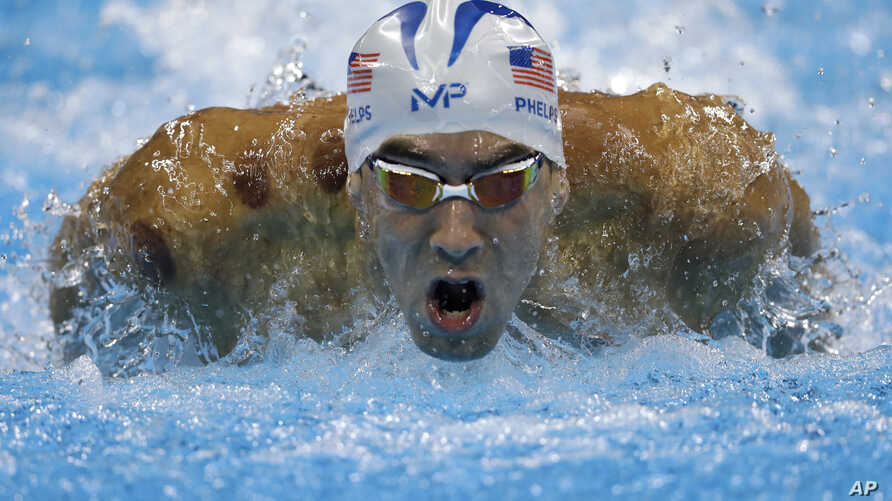 United States' Michael Phelps competes in a men's 200-meter butterfly heat during the swimming competitions at the 2016 Summer Olympics, Aug. 8, 2016, in Rio de Janeiro, Brazil.