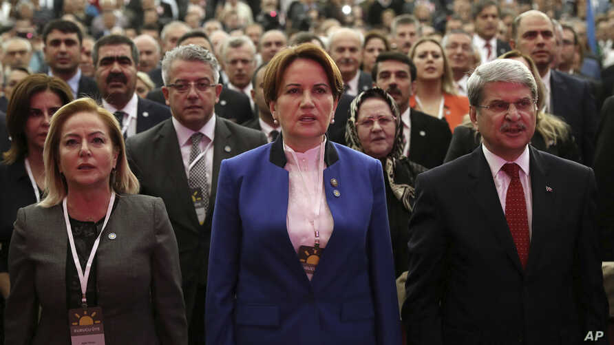 Meral Aksener, a former interior minister and deputy parliament speaker, center, attends her party's first meeting in Ankara, Turkey, Oct. 25, 2017. The new party of Aksener, 61, hopes to challenge President Recep Tayyip Erdogan in elections set for ...