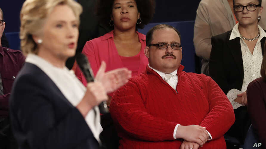 Kenneth Bone listens as Democratic presidential nominee Hillary Clinton answers a question during the second presidential debate with Republican presidential nominee Donald Trump at Washington University in St. Louis, Oct. 9, 2016.