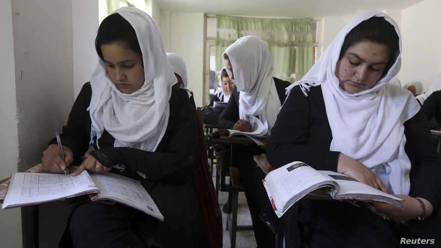 FILE - Girls are seen attending class at a school run by Aid Afghanistan for Education in Kabul May 13, 2014.