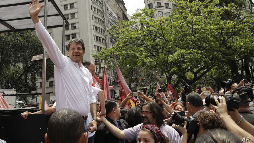 Sao Paulo's Mayor Fernando Haddad, of the Workers Party, greets supporters as he campaigns for re-election in Sao Paulo, Brazil, Sept. 30, 2016.