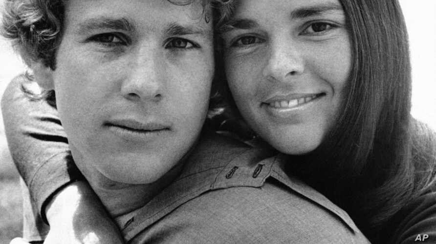 """Ali McGraw embraces Ryan O'Neal in a scenes from the film """"Love Story"""" 1970."""