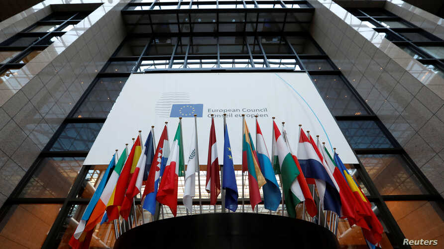 Flags are seen inside the European Council headquarters on the eve of a EU Summit in Brussels, Belgium, Dec. 14, 2016.
