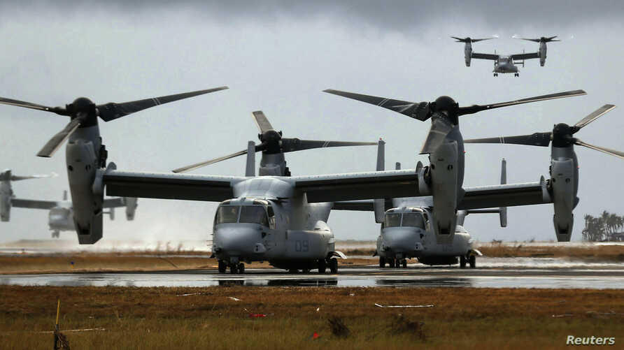 Four Ospreys from the U.S. Navy Ship (USNS) Charles Drew prepare to taxi on the tarmac of Tacloban airport in the aftermath of super typhoon Haiyan, Nov. 14, 2013.
