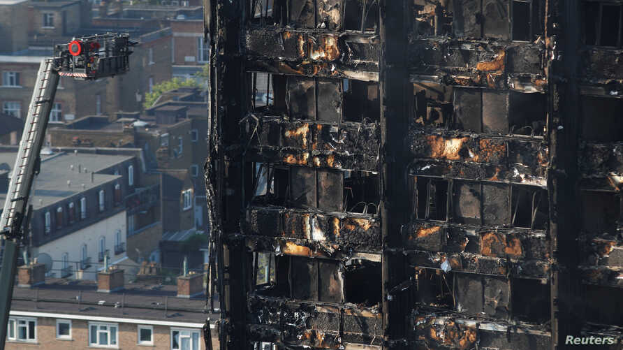 Damage is seen to a tower block which was destroyed in a fire disaster, in north Kensington, West London, Britain June 15, 2017.