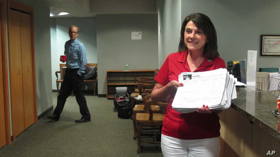 Republican U.S. Senate candidate Leah Vukmir submits nomination papers with Wisconsin elections officials in Madison, Wis., on Wednesday, May 30, 2018.