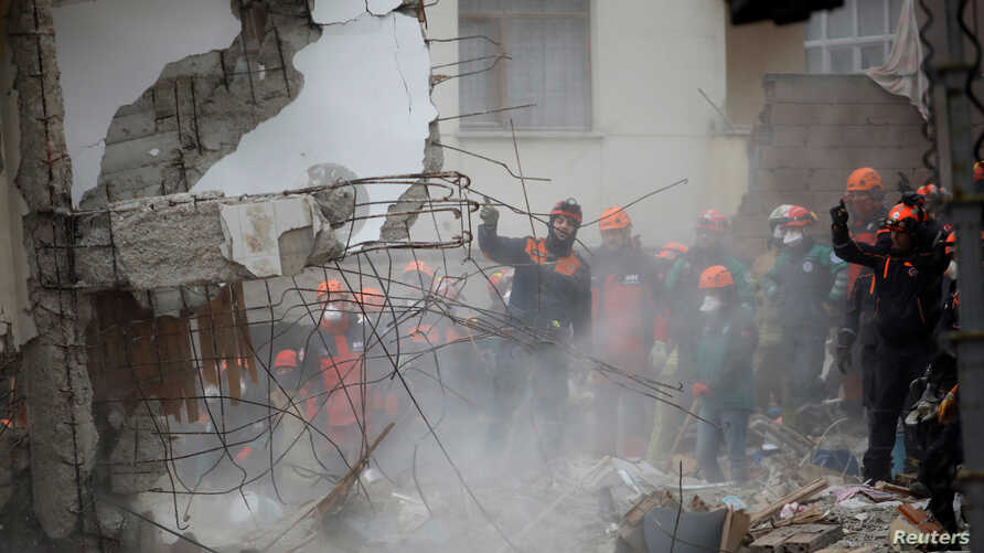 Rescue workers are seen at the site of a collapsed residential building in the Kartal district of Istanbul, Turkey, Feb. 7, 2019.