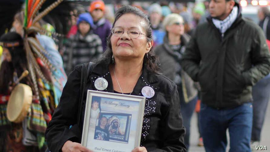 Lynn Eagle Feather in a protest demonstration against the police shooting of her son Paul Castaway in July 2015.