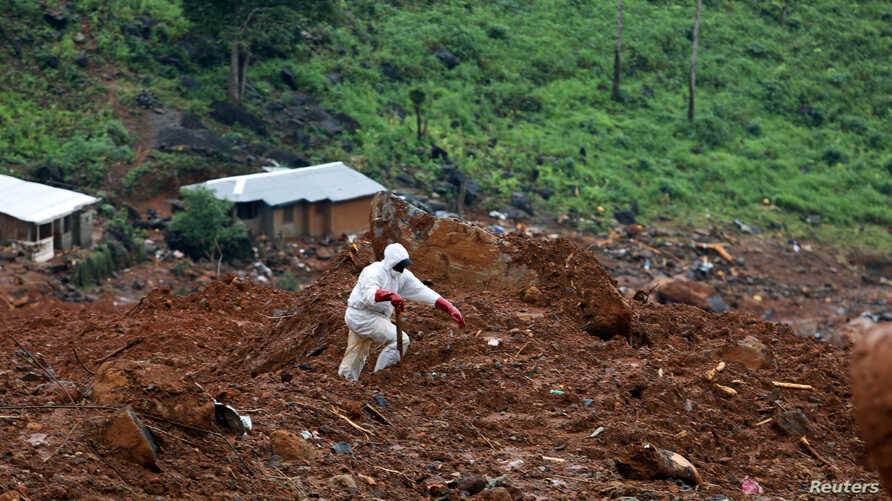 A rescue worker is seen at the scene of the mudslide in the mountain town of Regent, Sierra Leone, Aug. 16, 2017.