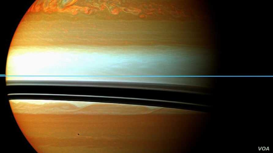 These red, orange and green clouds (false color) in Saturn's northern hemisphere indicate the tail end of a massive storm that started in December 2010. Even after visible signs of the storm started to fade, infrared measurements continued to reveal