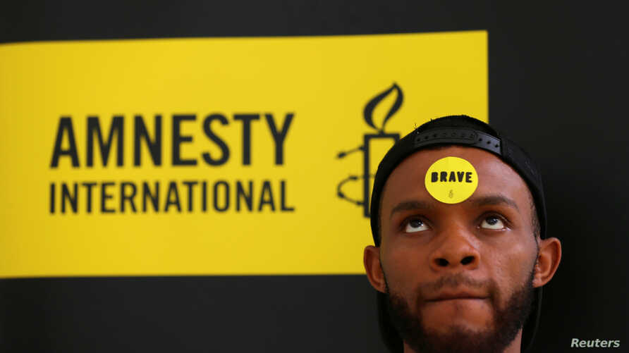FILE - Human rights campaigner looks on during the release of an Amnesty International report in Abuja, Nigeria, May 16, 2017.