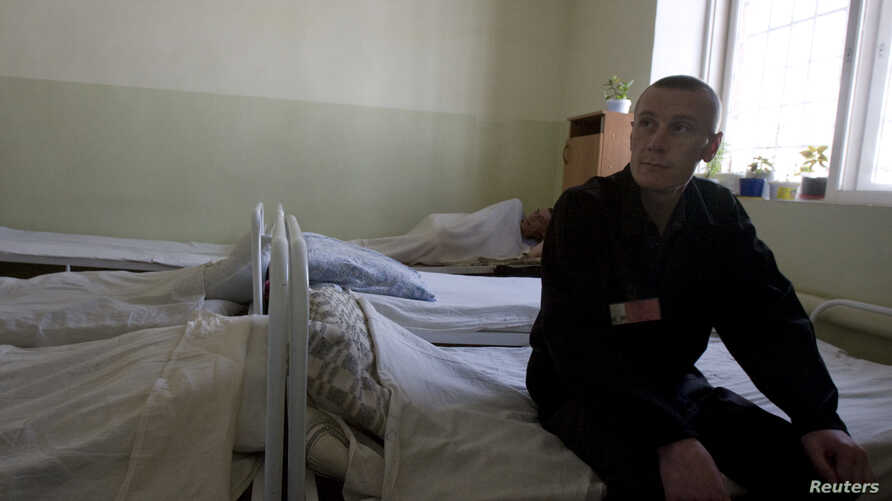 FILE - A inmate sits in the multi-drug resistant tuberculosis [MDR-TB] ward in a prison hospital in the Siberian city of Tomsk, about 3,500 kilometers east of Moscow, Russia.