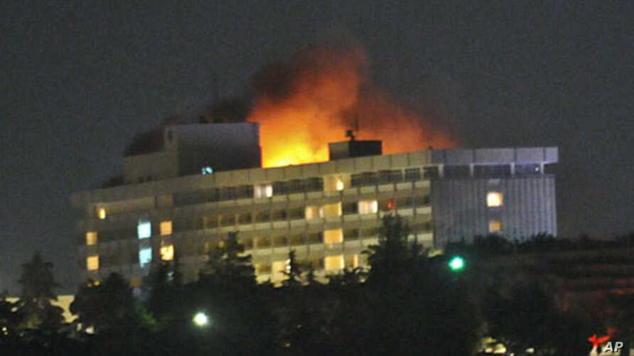 Smoke and flames light up the night from a blaze at the Intercontinental hotel after an attack on the hotel by Taliban fighters and a response by Afghan security forces backed by NATO helicopters in Kabul, June 29, 2011
