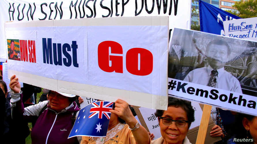 Protesters hold placards and banners during a demonstration against Cambodia's Prime Minister Hun Sen, who is attending the one-off summit of 10-member Association of Southeast Asian Nations (ASEAN), in Sydney, Australia, March 16, 2018.