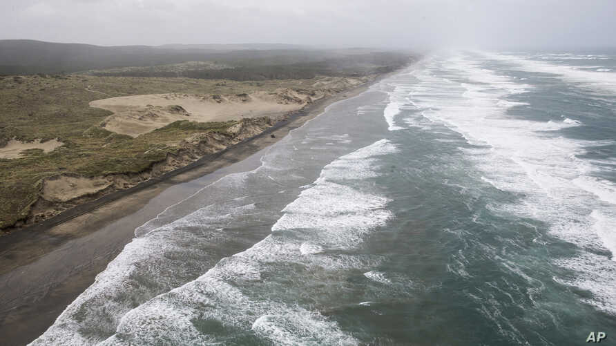 Muriwai beach is seen Nov. 27, 2016, after the chartered fishing boat Francie disappeared off Auckland, New Zealand. The Francie,  carrying 11 people, disappeared in large waves Saturday at the entrance to Kaipara Harbour near Auckland.