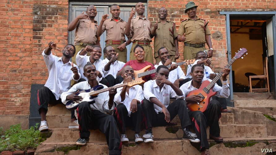 Members of the Prison Reform Band outside their makeshift recording studio at the Zomba maximum-security prison in eastern Malawi. (Credit: L. Masina/VOA)