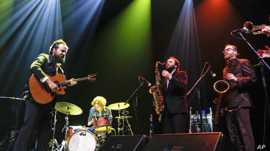 Iron & Wine's Sam Beam performs with his new band at the SXSW Music Festival in Austin, Texas, March 13, 2013.