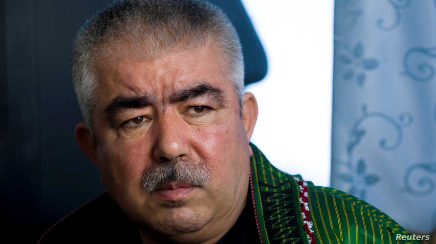 FILE - Then Afghan general Abdul Rashid Dostum speaks during an interview in Shibergan, northern Afghanistan, Aug. 19, 2009.