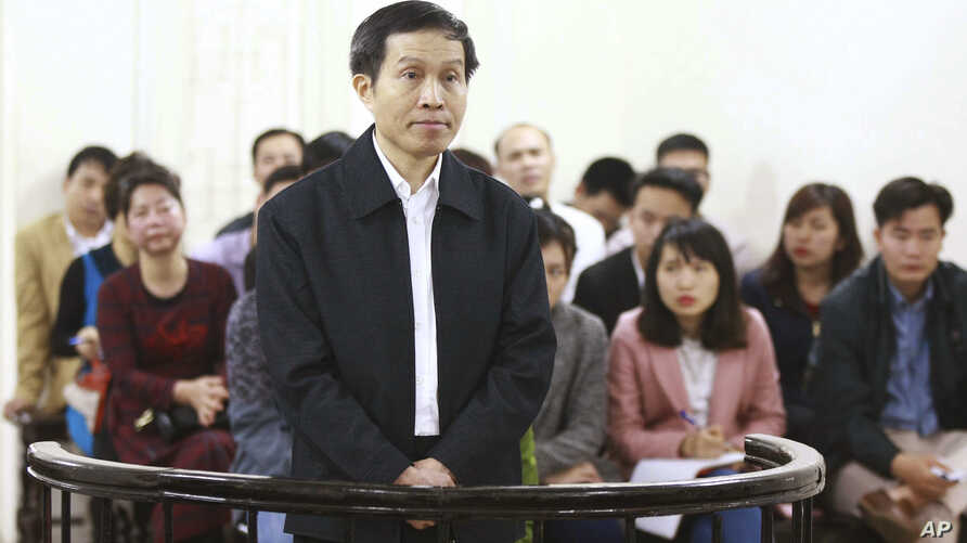 FILE - Vietnam's prominent blogger Nguyen Huu Vinh, shown on trial in Hanoi, Vietnam, was sentenced to five years in prison for posting anti-state writings, March 23, 2016. Human rights will be on the agenda during U.S. President Barack Obama's visit