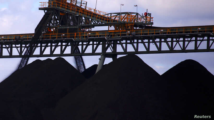 Coal is unloaded onto large piles at the Ulan Coal mines near the central New South Wales town of Mudgee in Australia, March 8, 2018.