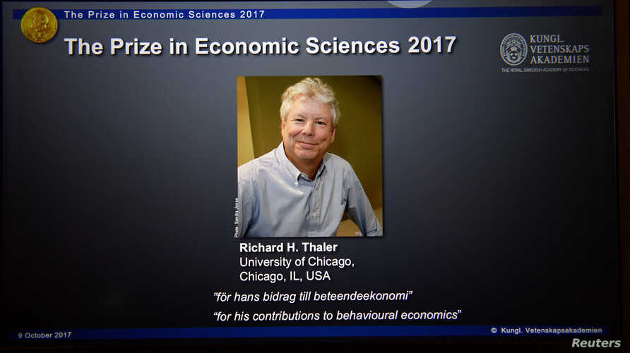 A photo of Richard H. Thaler, winner of the Nobel Prize in economic sciences 2017, officially called the Sveriges Riksbank Prize in Economic Sciences in Memory of Alfred Nobel, is seen during a press conference in Stockholm, Oct. 9, 2017.
