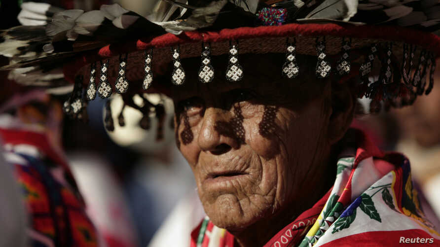 A Huichol elder, wearing a traditional hat, takes part in a protest in Mexico City Oct. 27, 2011, against the construction of a silver mine in Wirikuta, one of the Huichol indigenous community's sacred ceremonial sites.