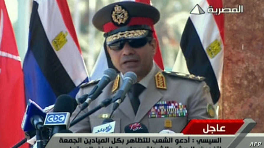 """FILE - An image grab taken from Egyptian state TV shows Egypt's army chief General Abdel Fattah al-Sisi giving a live broadcast calling for public rallies this week to give him a mandate to fight """"terrorism and violence,"""" as Mohamed Morsi's supporter"""
