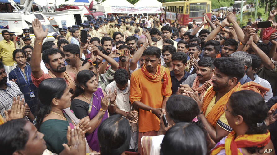 Protesters who are opposed to allowing women of menstruating age to enter the Sabarimala temple chant devotional hymns as they gather at Nilackal, a base camp on way to the mountain shrine in Kerala, India, Oct. 17, 2018.