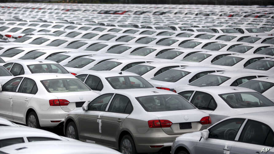 FILE - Volkswagen Jettas produced in Mexico for export are parked at the port terminal in the Gulf city of Veracruz, Mexico.