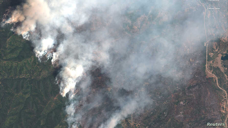 A satellite image shows the 416 Wildfire burning west of Highway 550 and northwest of Hermosa, Colorado, June 10, 2018.