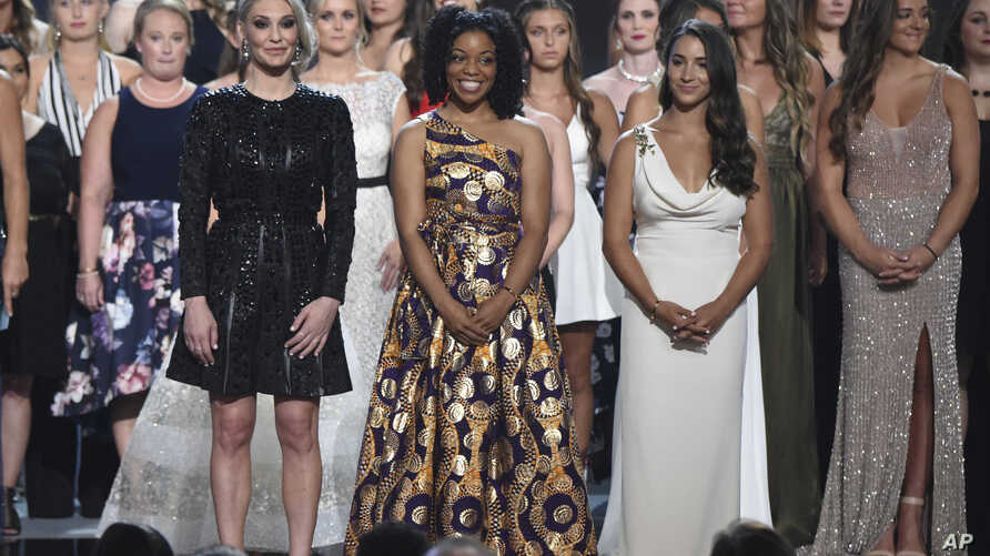 (From L-Front) Former gymnast Sarah Klein, former Michigan State softball player Tiffany Thomas Lopez and gymnast Aly Raisman, and others who suffered sexual abuse accept the Arthur Ashe Award for Courage at the ESPY Awards at the Microsoft Theater o